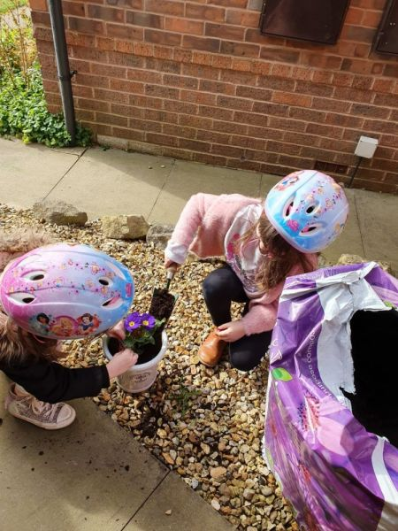 poppy-and-Carmen-gardening